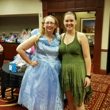 Tinkerbell and Cinderella attend the princess party.